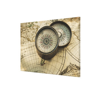 Antique compass on map canvas print
