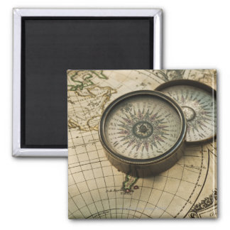 Antique compass on map magnet