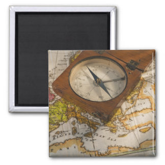 Antique compass on map magnets