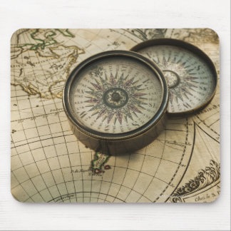Antique compass on map mouse mat