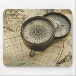 Antique compass on map mousemats