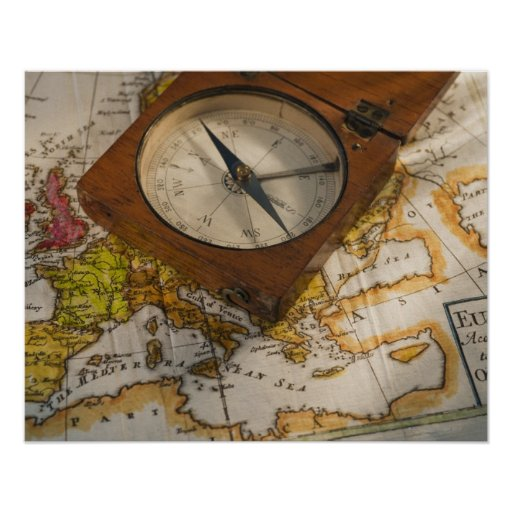 Antique compass on map poster
