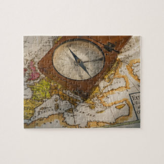Antique compass on map puzzle