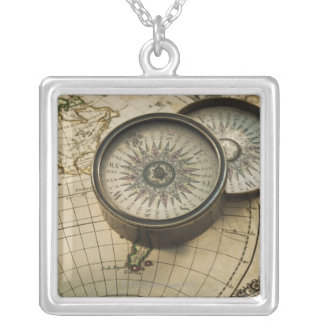 Antique compass on map silver plated necklace