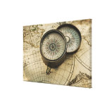 Antique compass on map stretched canvas prints