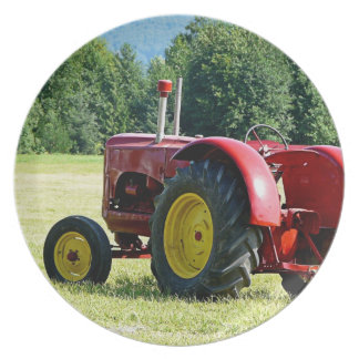 Antique Red and Yellow Tractor in Field Plate