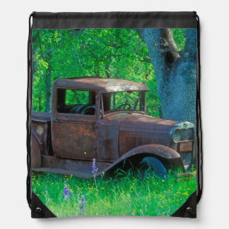 Antique rusted truck in a meadow drawstring bag