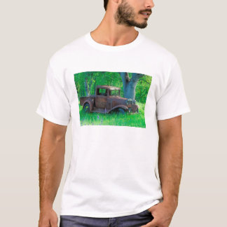 Antique rusted truck in a meadow T-Shirt