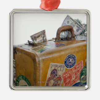 Antique suitcase with protruding money christmas ornament
