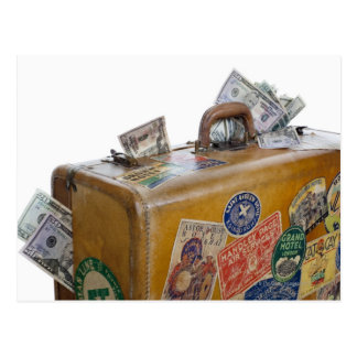 Antique suitcase with protruding money postcard