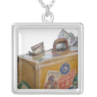 Antique suitcase with protruding money silver plated necklace