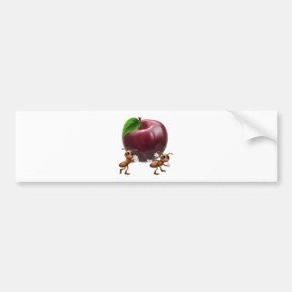 Ants carrying a big apple bumper sticker