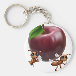 Ants carrying a big apple keychains