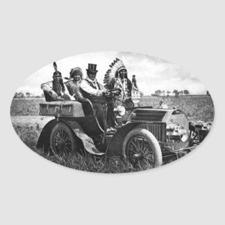 APACHES AND GERONIMO DRIVING A MOTOR CAR OVAL STICKER