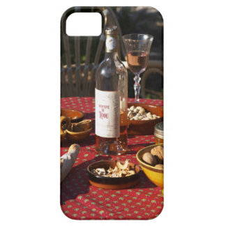 Aperitif and appetizers prepared: bread, olives, iPhone 5 cases