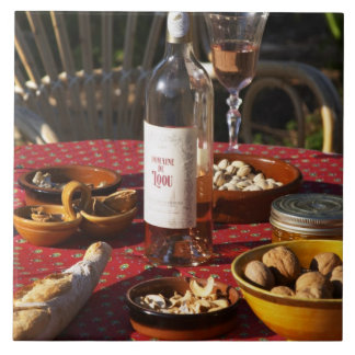Aperitif and appetizers prepared: bread, olives, large square tile