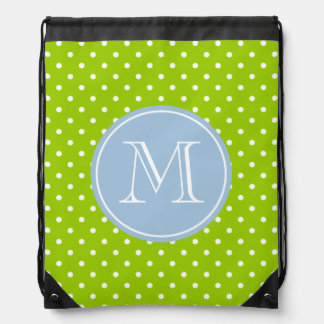 Apple green drawstring bag with white polka dots