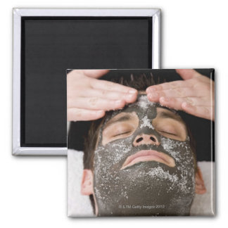 Applying skincare face mask with salt square magnet