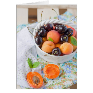 Apricots and cherries in a bowl card