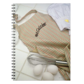 Apron with eggs and whisk notebook