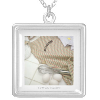 Apron with eggs and whisk silver plated necklace