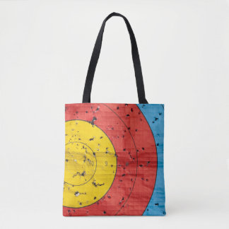 Archery target close up with many arrow holes tote bag