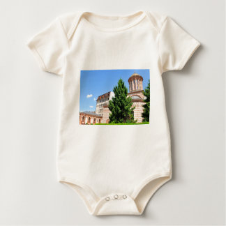 Architectural detail of old Romanian church Baby Bodysuit