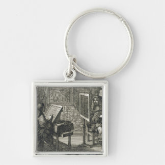 Artist painting a portrait over a grid for accurat Silver-Colored square key ring