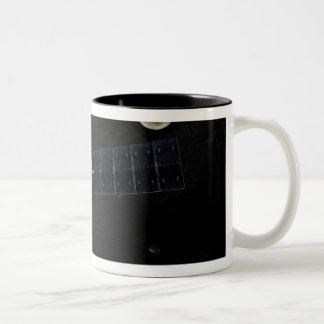 Artist s concept of the Dawn spacecraft in orbi Coffee Mug