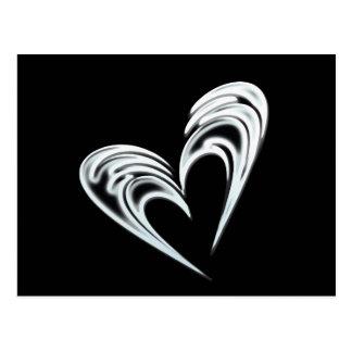 Artistic white heart on black background postcard