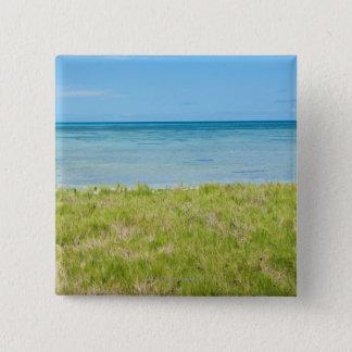 Aruba, grassy beach and sea 15 cm square badge