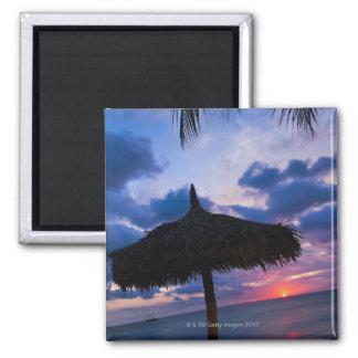 Aruba, silhouette of palapa on beach at sunset 2 magnet