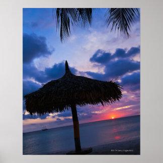 Aruba, silhouette of palapa on beach at sunset 2 poster