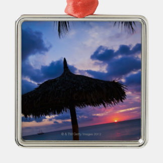 Aruba, silhouette of palapa on beach at sunset 2 Silver-Colored square decoration