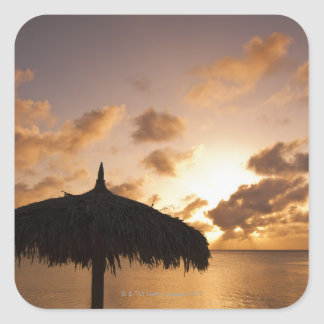 Aruba, silhouette of palapa on beach at sunset square sticker