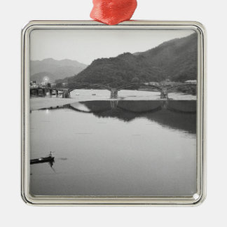 Asia, Japan, Iwakuni. Fishermen and historic Silver-Colored Square Decoration