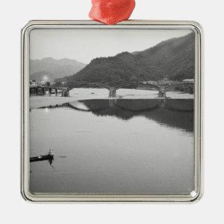 Asia, Japan, Iwakuni. Fishermen and historic Silver-Colored Square Decoration