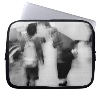 Asia, Japan, Tokyo. Young women and umbrellas. Laptop Sleeve