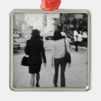 Asia, Japan, Tokyo. Young women on the Ginza. Silver-Colored Square Decoration