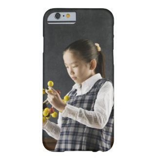 Asian girl looking at molecule model barely there iPhone 6 case