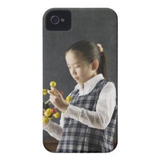 Asian girl looking at molecule model iPhone 4 cases