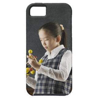 Asian girl looking at molecule model iPhone 5 covers