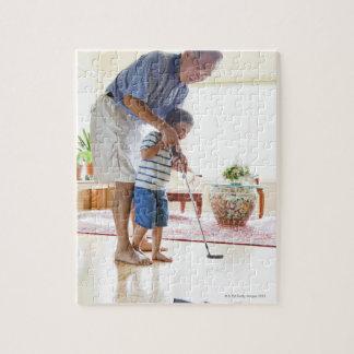 Asian Grandfather teaching his Half-Asian Jigsaw Puzzle