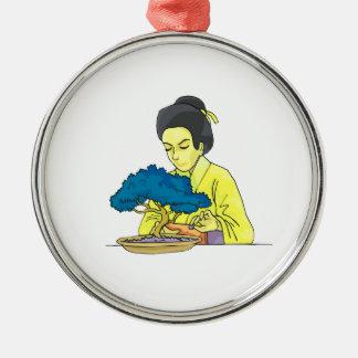 asian lady tending bonsai tree bluish png christmas ornaments