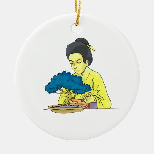 asian lady tending bonsai tree bluish.png christmas ornaments