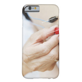 Asian woman (70-75 years old) putting red and barely there iPhone 6 case