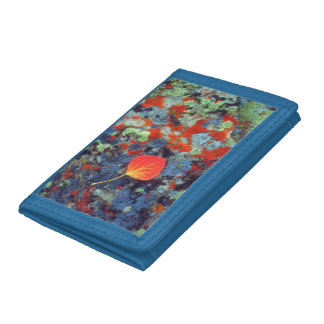 Aspen leaf on a lichen covered rock trifold wallets