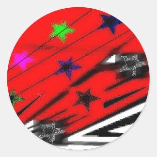 assorted items with artwork round sticker