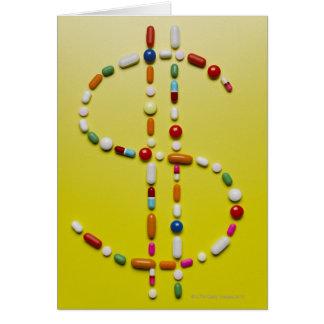 Assorted pills creating dollar symbol card