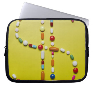 Assorted pills creating dollar symbol laptop sleeve